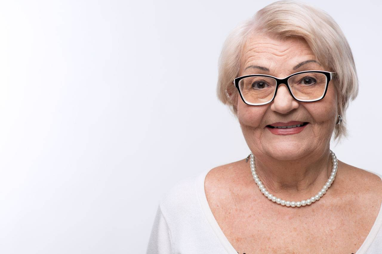 smiling older woman on eye disease ad